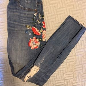 Distressed, stitched jeans